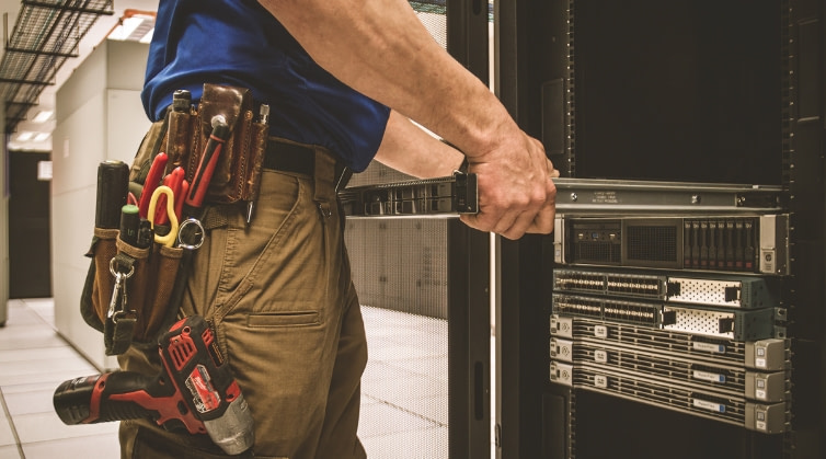 technician-pulling-out-switch